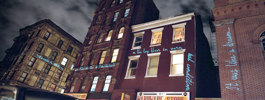 "©  Shimon Attie  I remember when we lived in a tenement on the top floor in   very bad condition. It was like a dream.... , Lasers Writing Out Jewish Senior's Memory, On-location laser projection installation at 1:1 architectural scale and 24"" X 65""photographm 1998, Shimon Attie, from the project  Between Dreams and History , Shimon Attie, 1998, courtesy of Jack Shainman Gallery, NY"