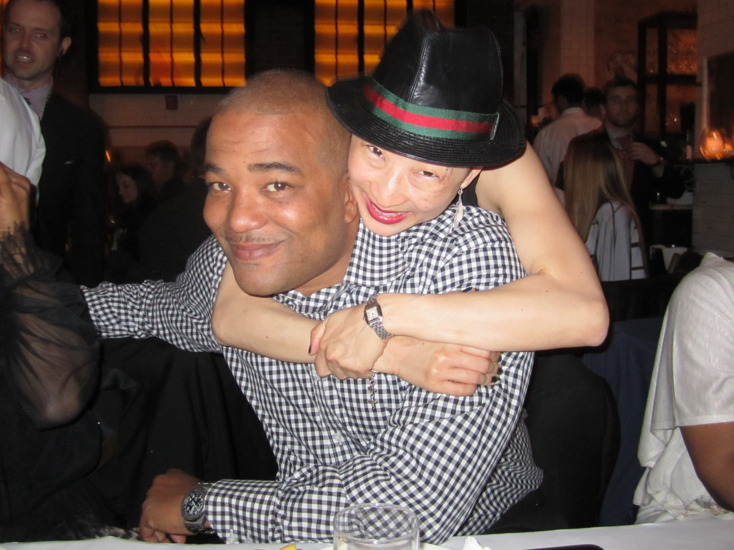 Chris' birthday party. Yet another picture wherein I hug him with all my might and he grits his teeth through it.