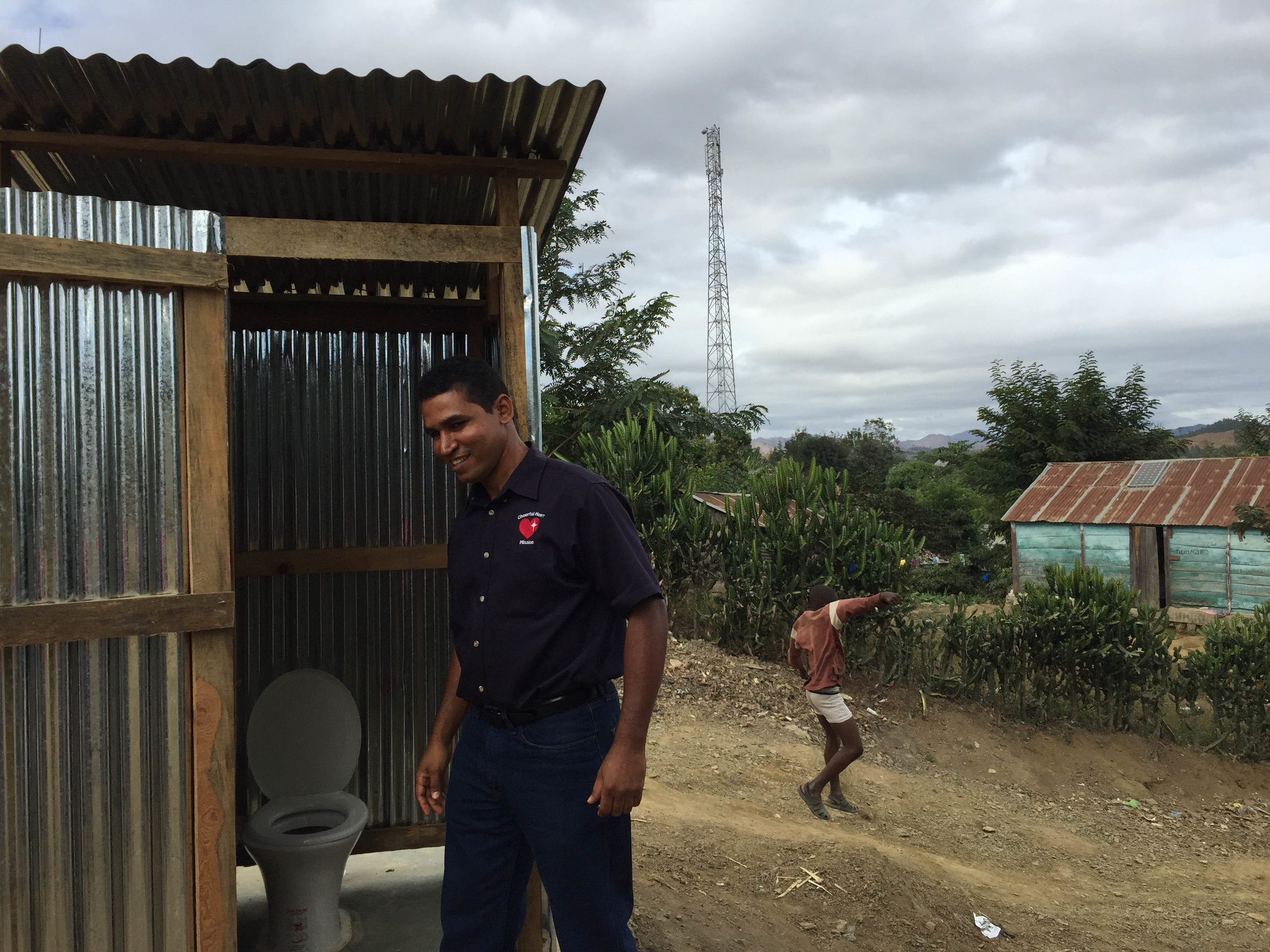 Luis Fragoso with a Newly Constructed Latrine in Tilori, Haiti