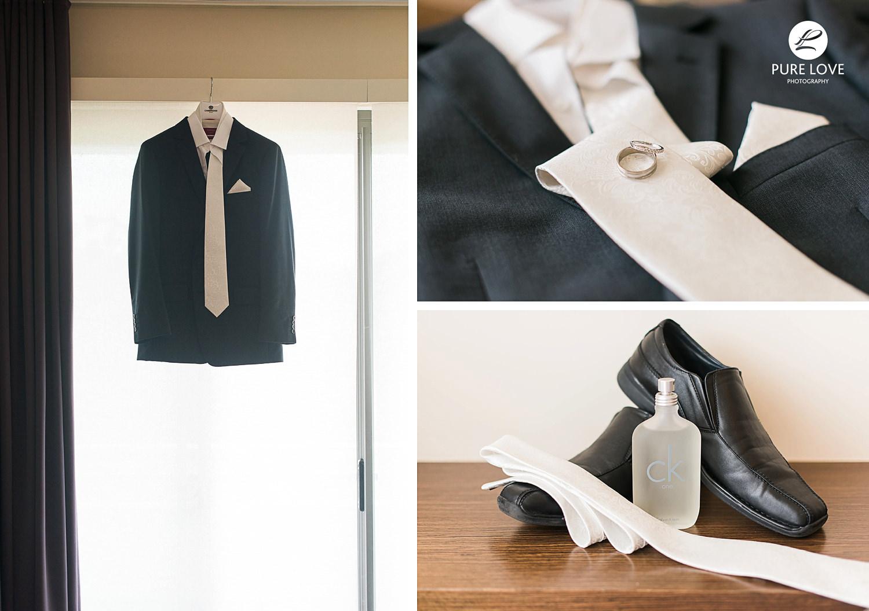 groom's suit hanging. grooms details. rings