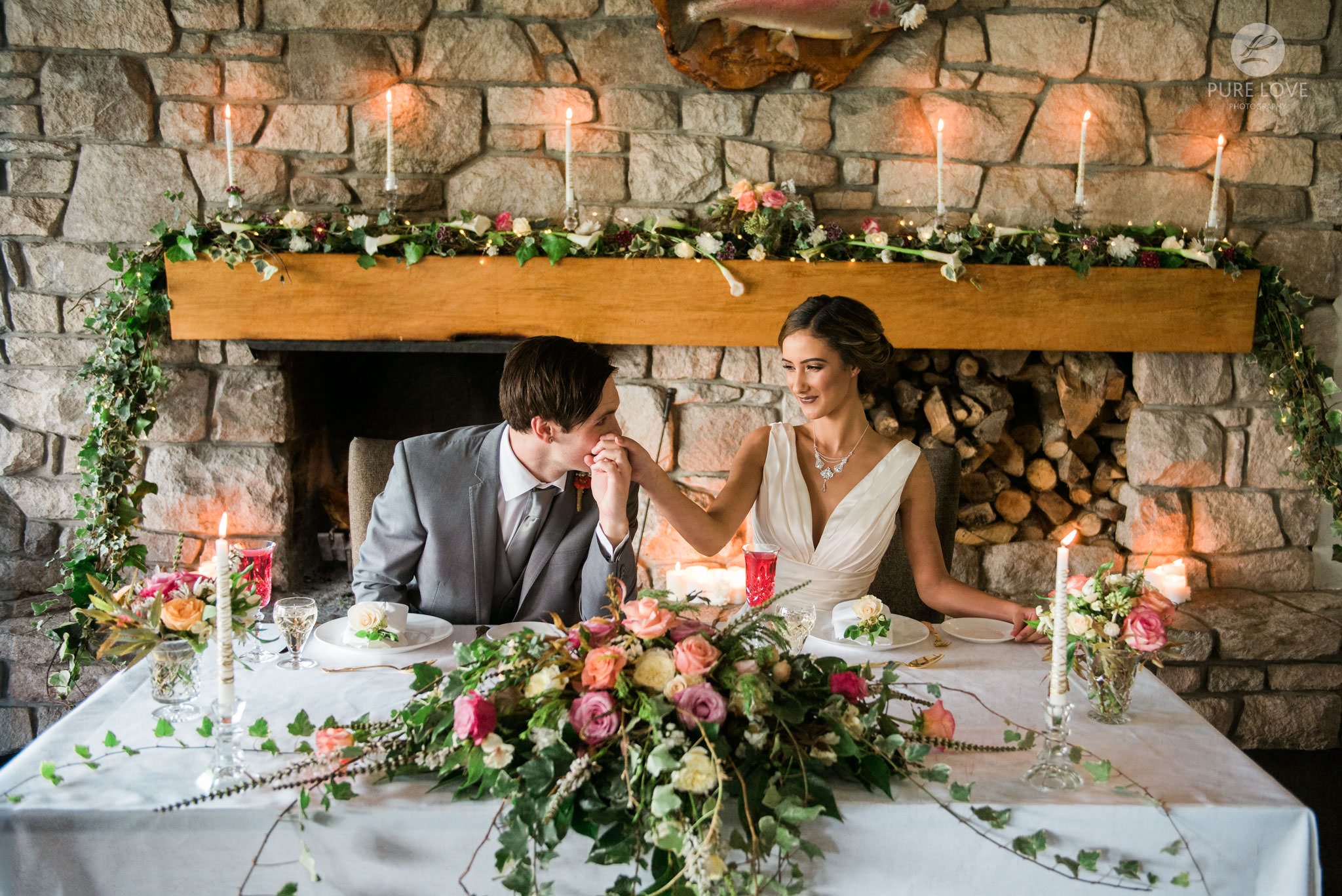 wedding reception by fire place with candles