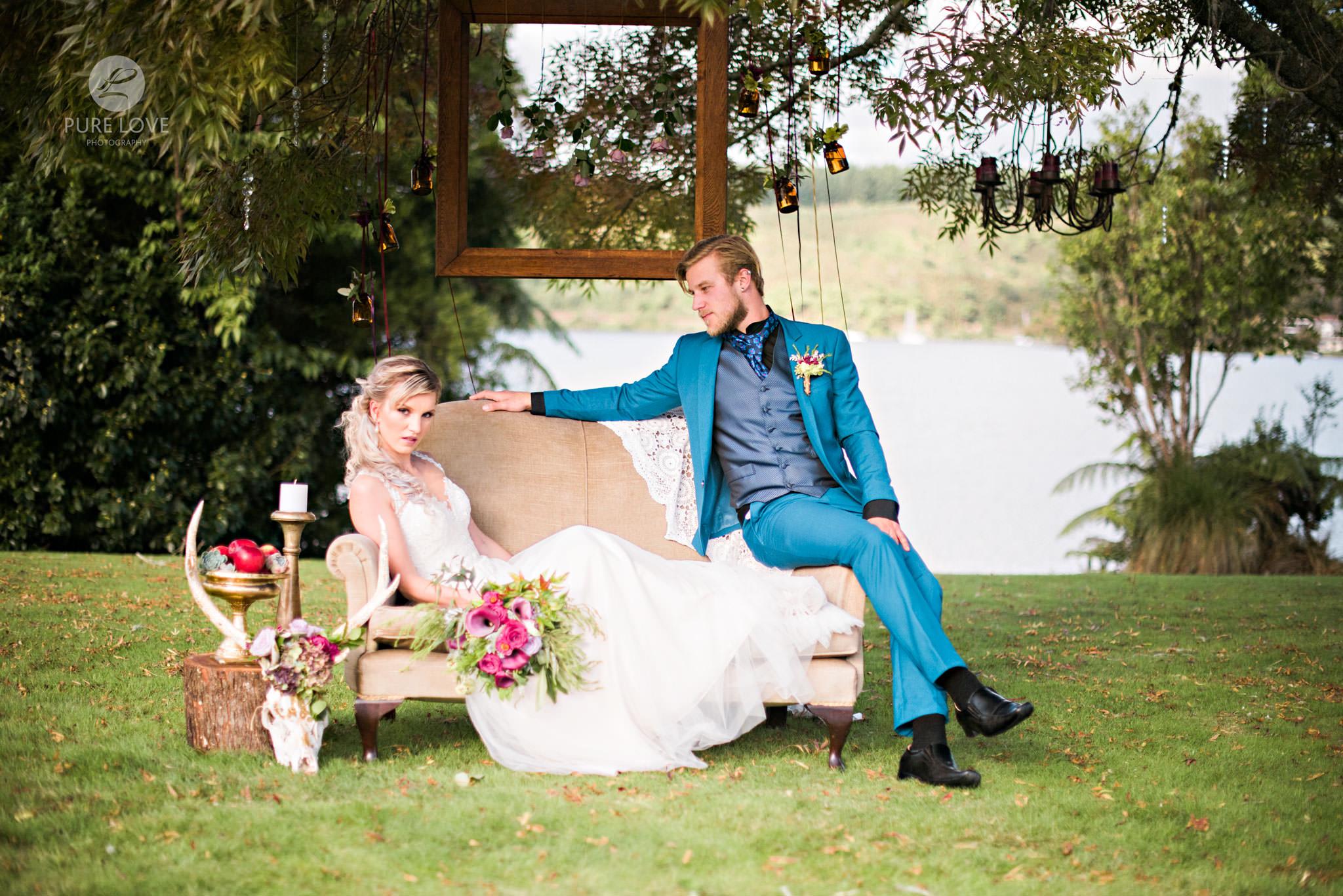 Boho styled wedding bride on couch