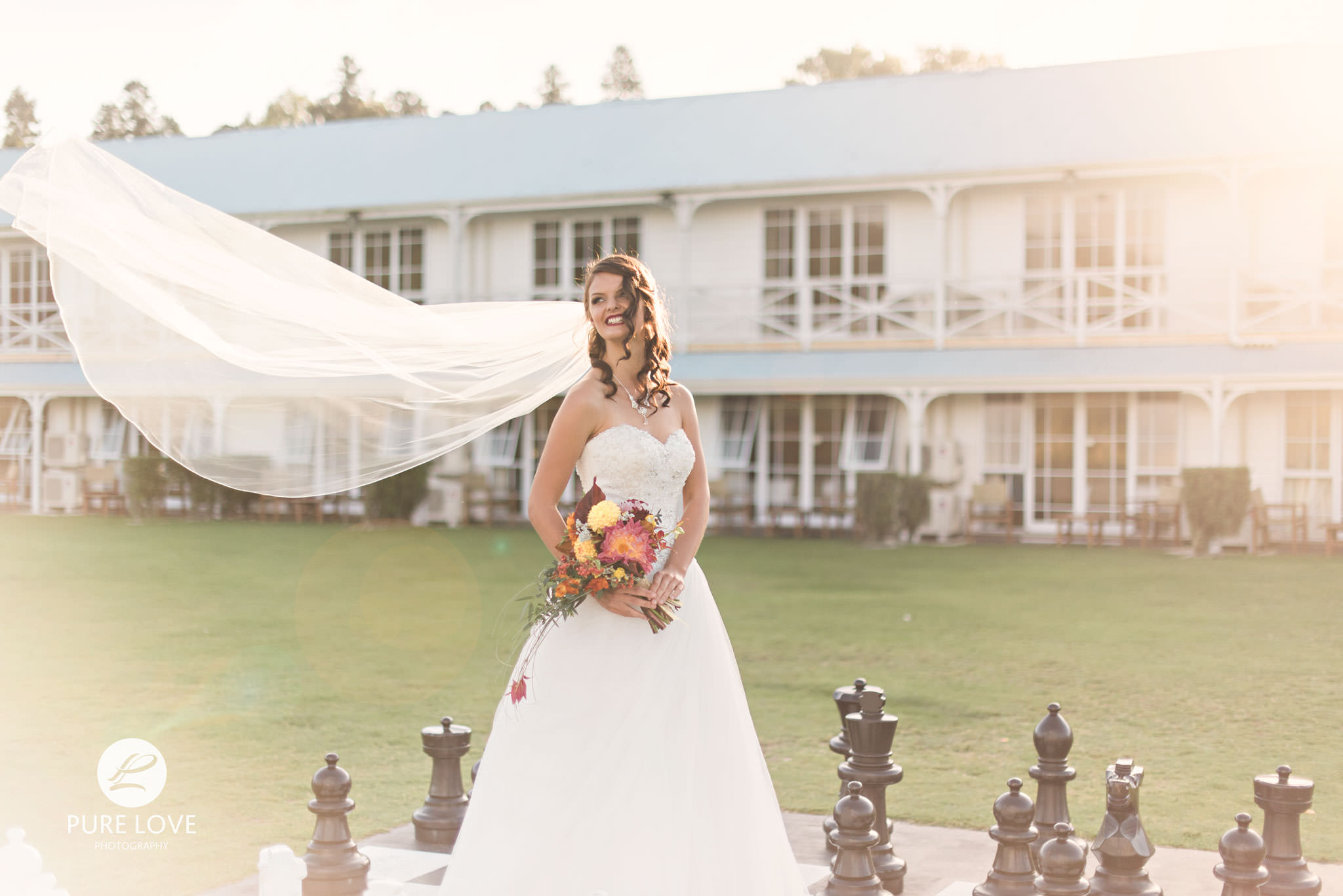 happy bride with flying veil at vr lake resort