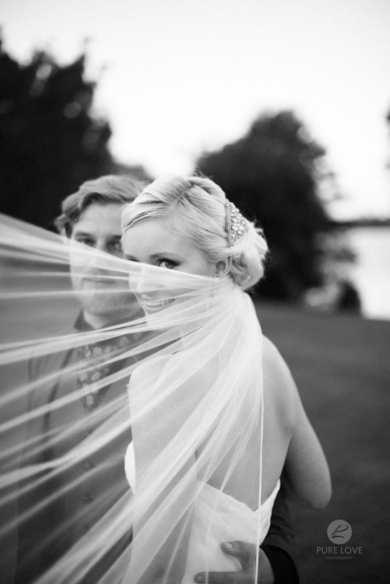 bride and groom with veil black and white