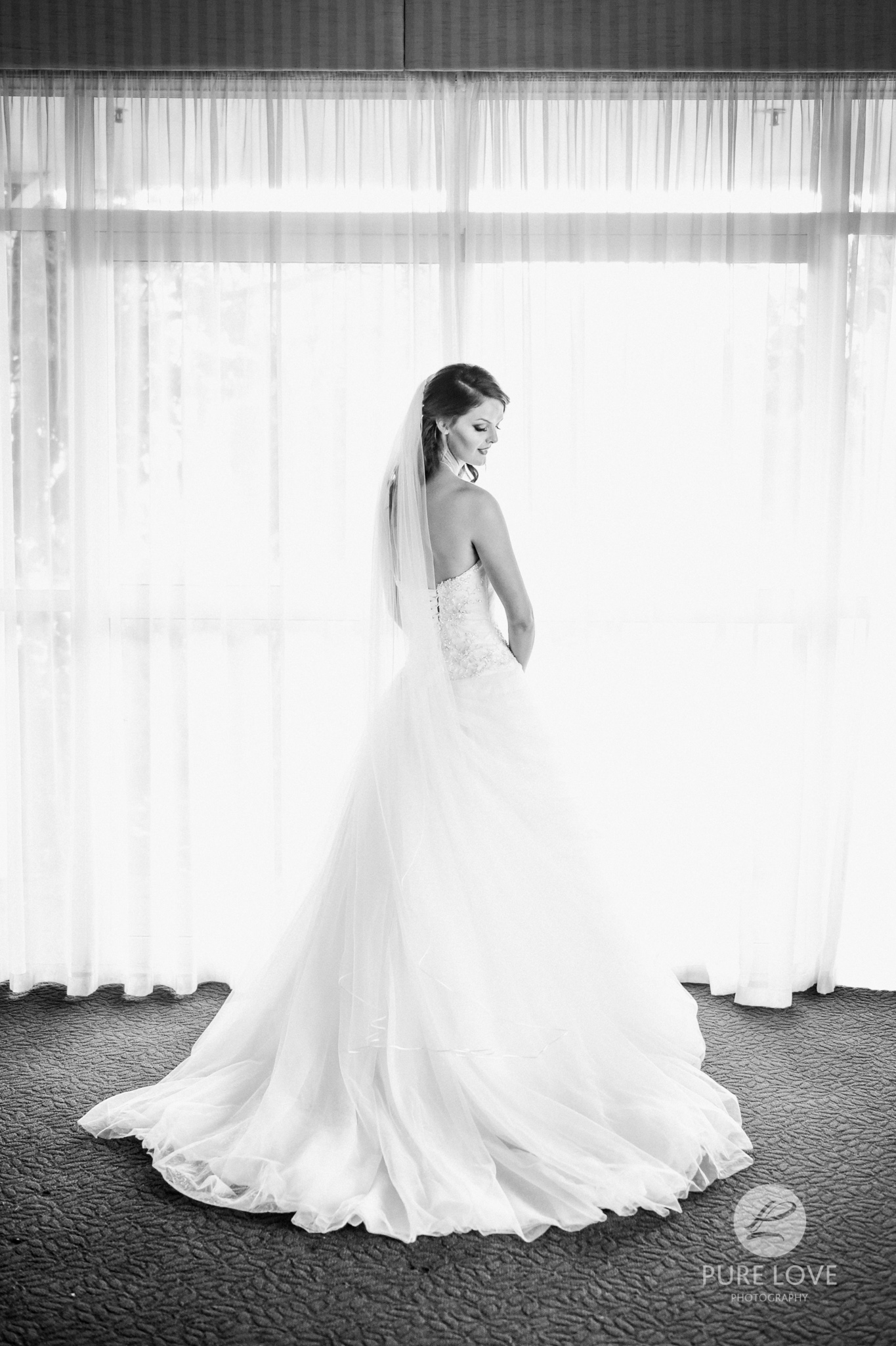 bride's portrait with curtains black and white