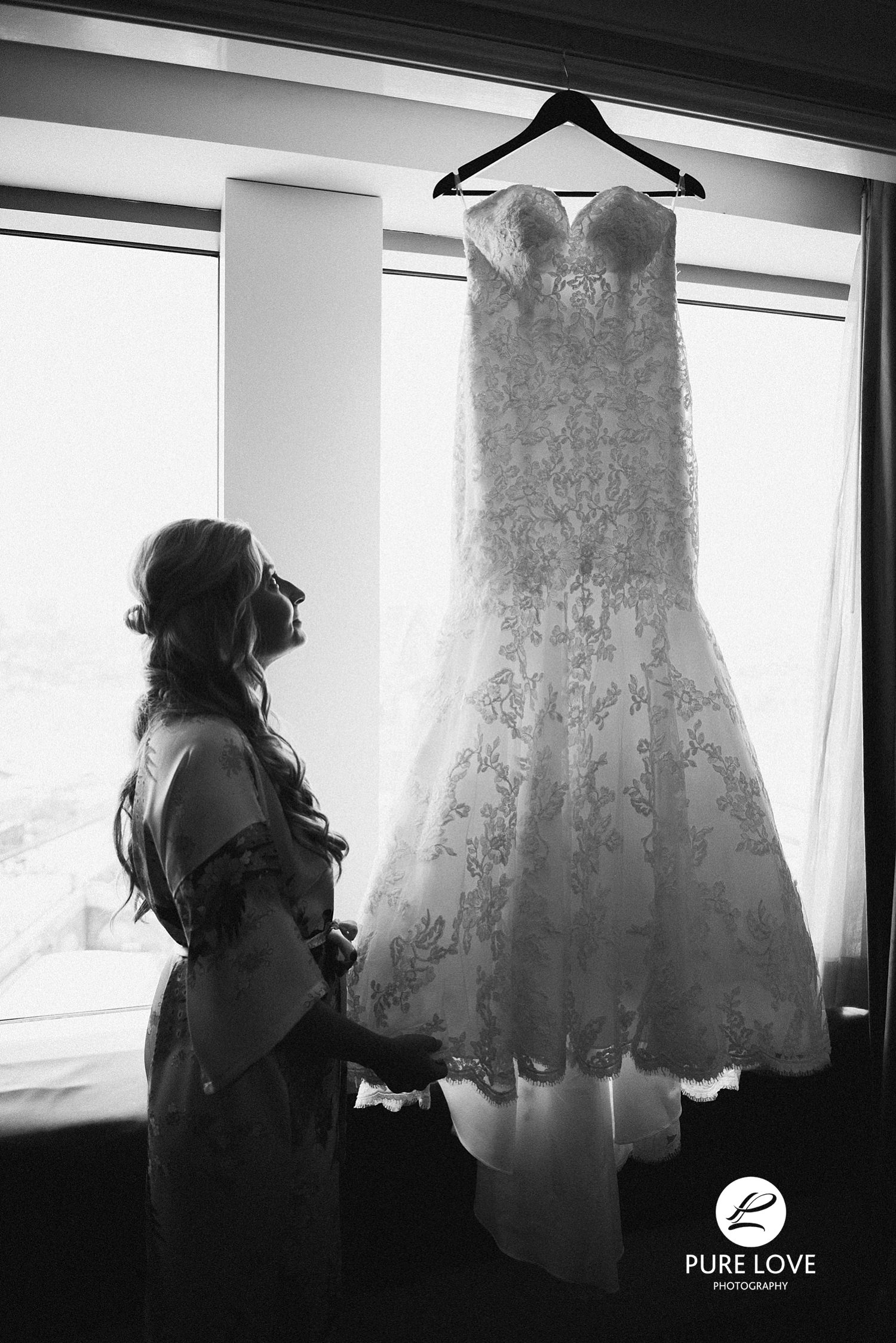 Bride looking at her dress. Bride and her wedding gown.