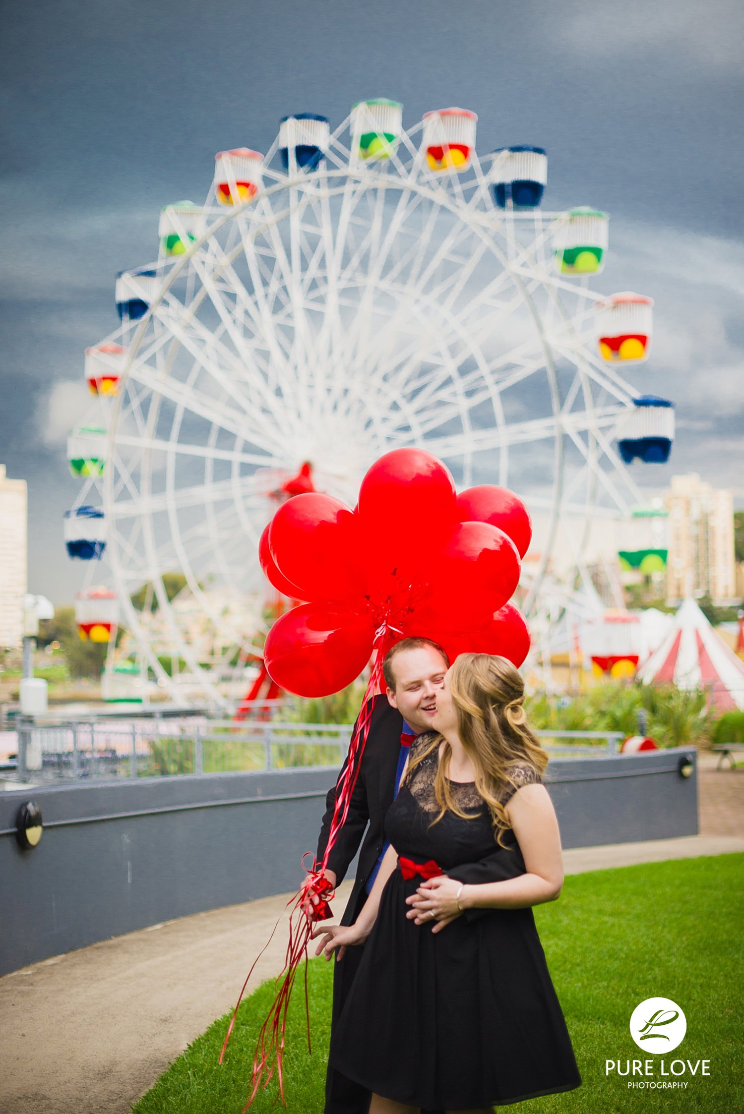 Fun Couple at amusement park during their engagement session. Lots of fun