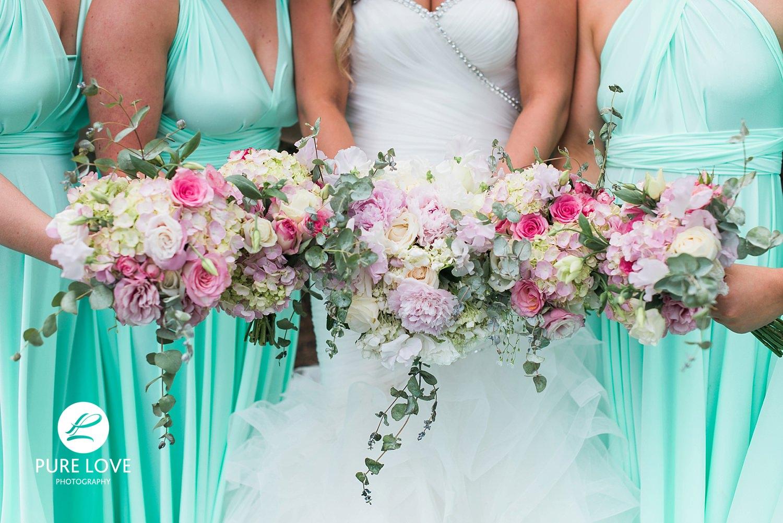 light green bridesmaids dresses colourful flowers