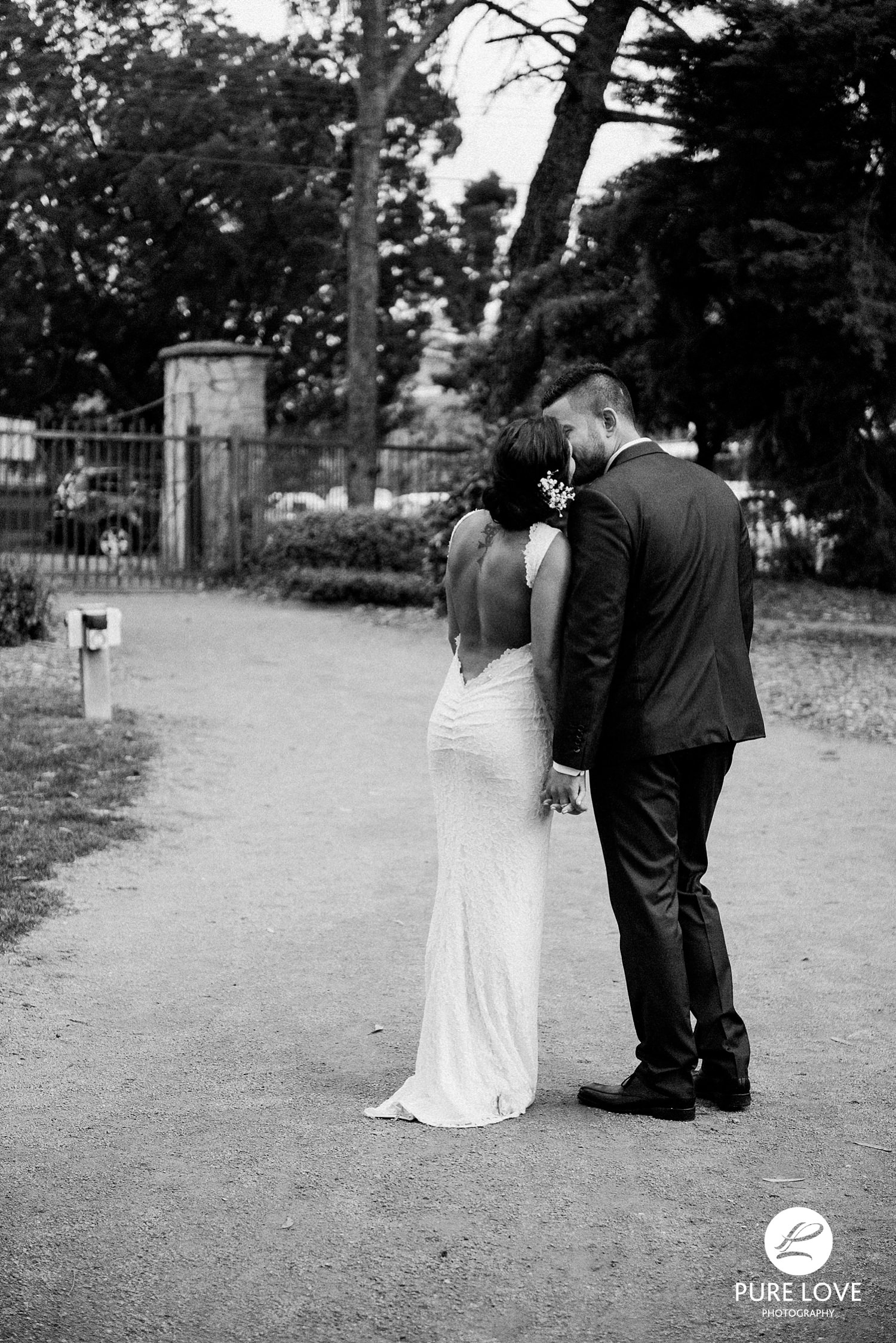 bride and groom black and white backless dress