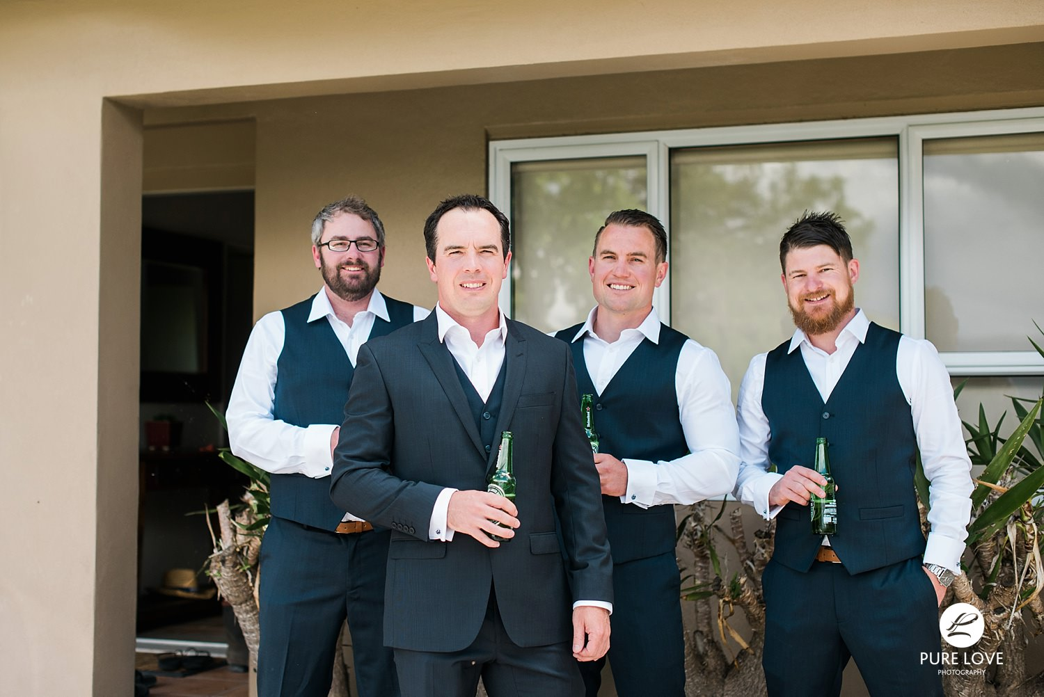 groom and groomsmen happy