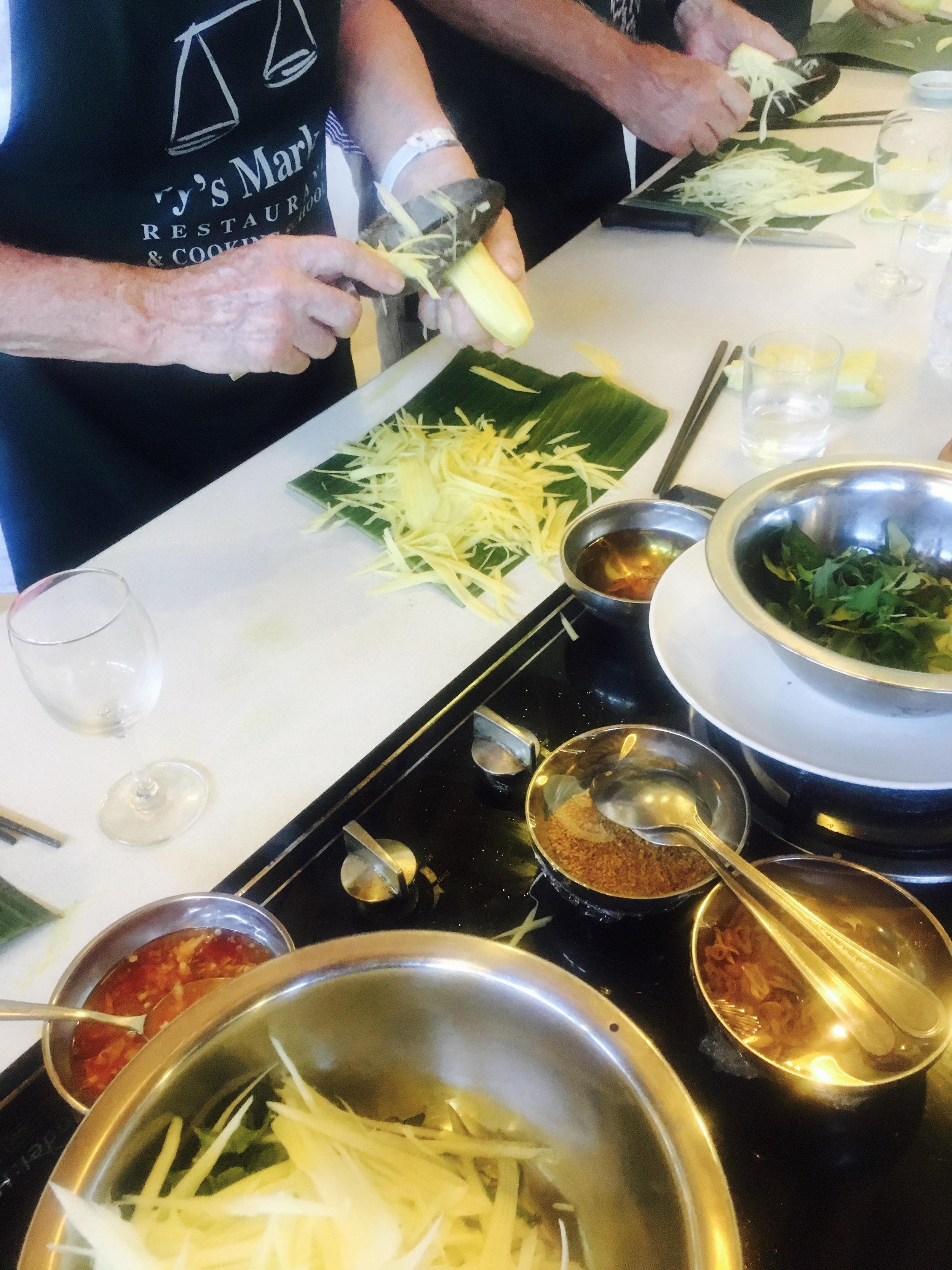 Making green papaya salad at Ms. Vy's Market Restaurant