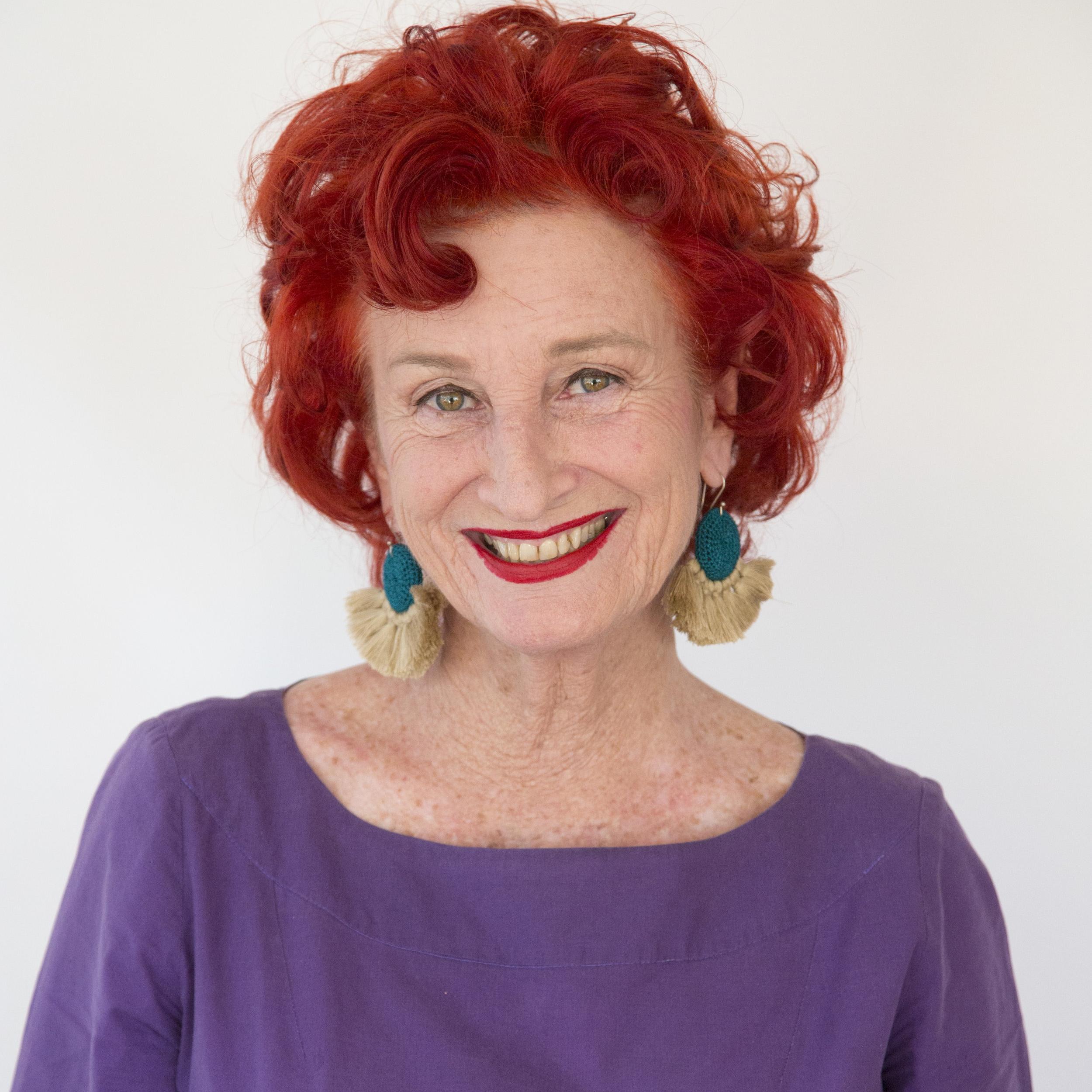 Peta wearing her CROCHET DISC TASSEL EARRINGS in turquoise & straw