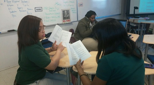 Briana Thomas and Trayona Lawrence, discussing the symbolism of the novel The Great Gatsby.