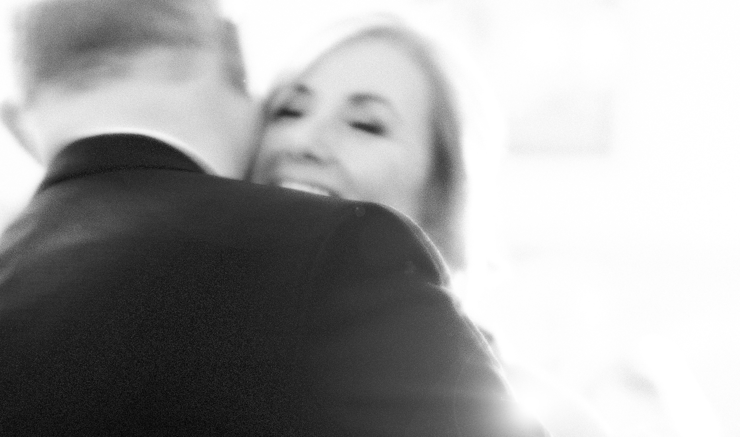 The Wedding Couple, Tracy & Clive embrace on the dance floor during their First Dance. © Wedding Photography by Vivid Confetti