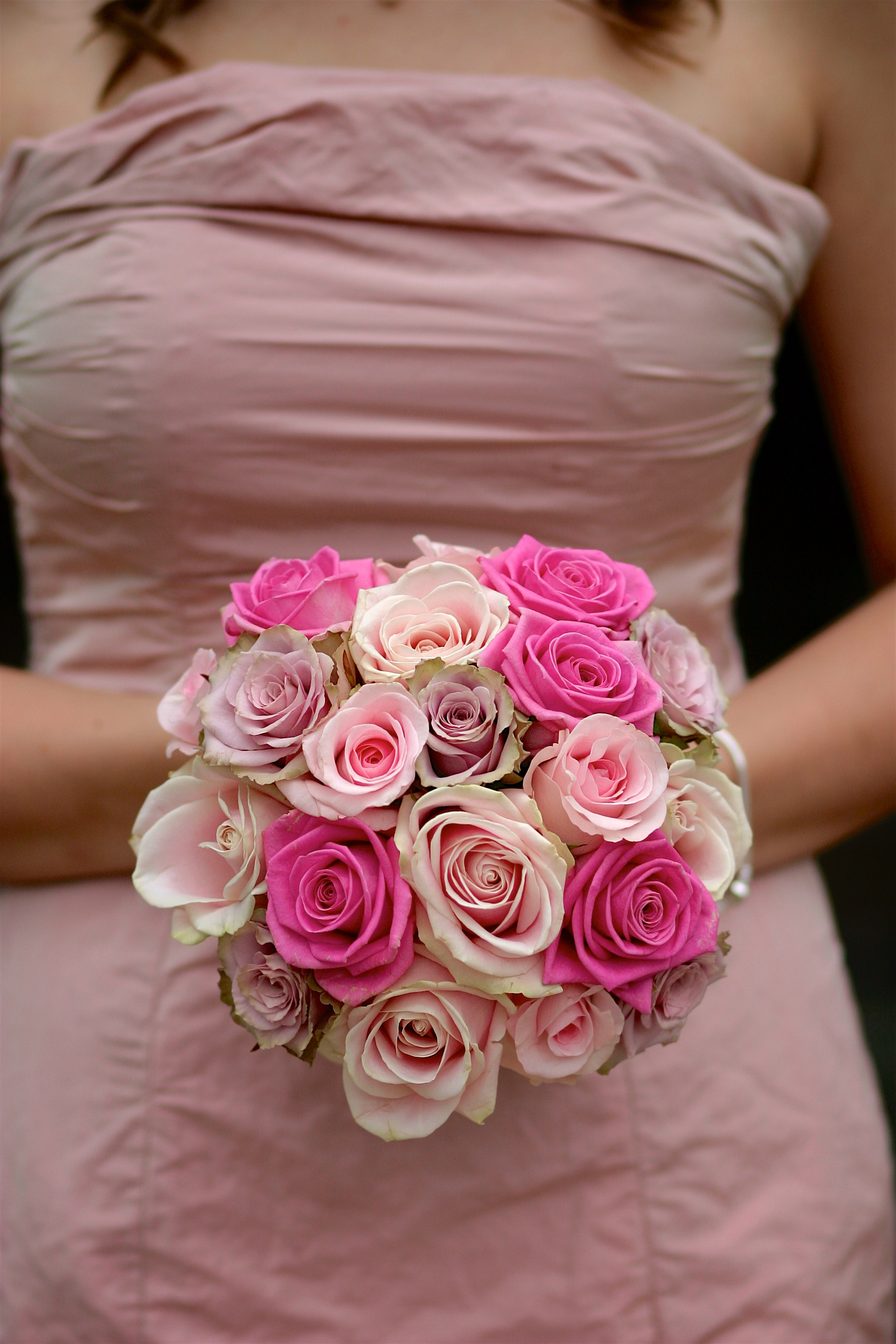Bridesmaid with a bouquet of flowers