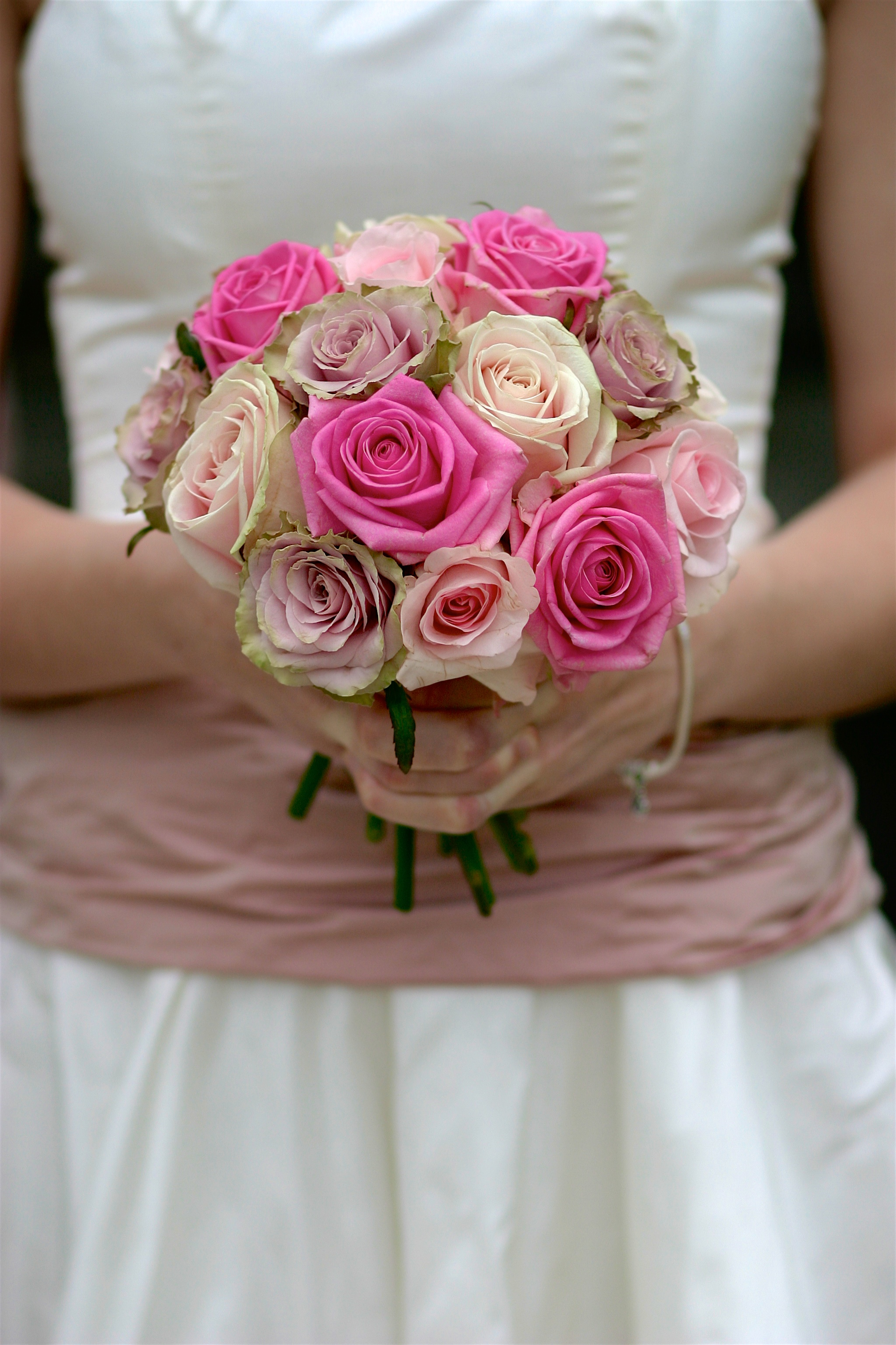 Bridesmaid with bouquet of flowers
