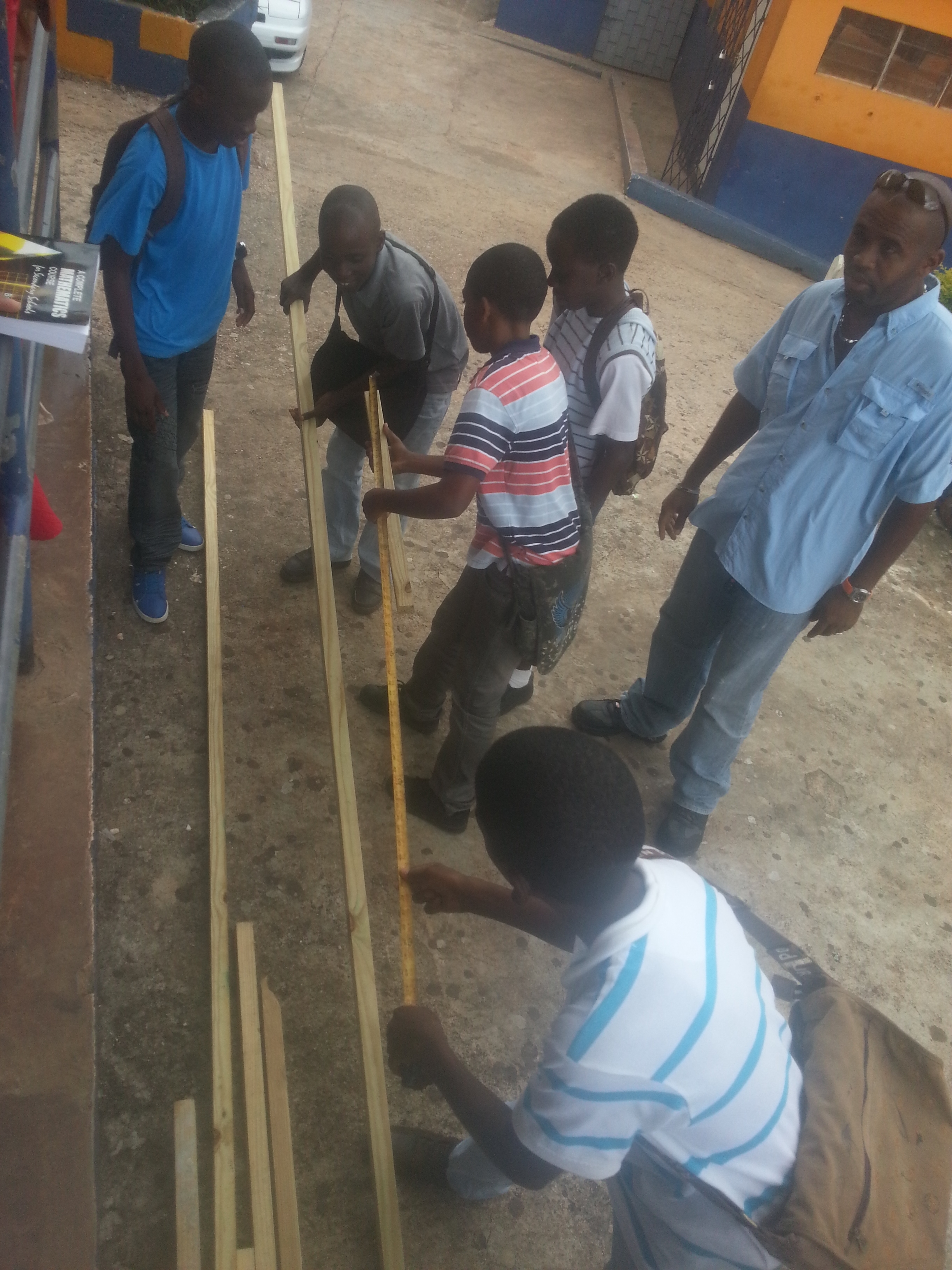 boys using maths to construct ladder.JPG