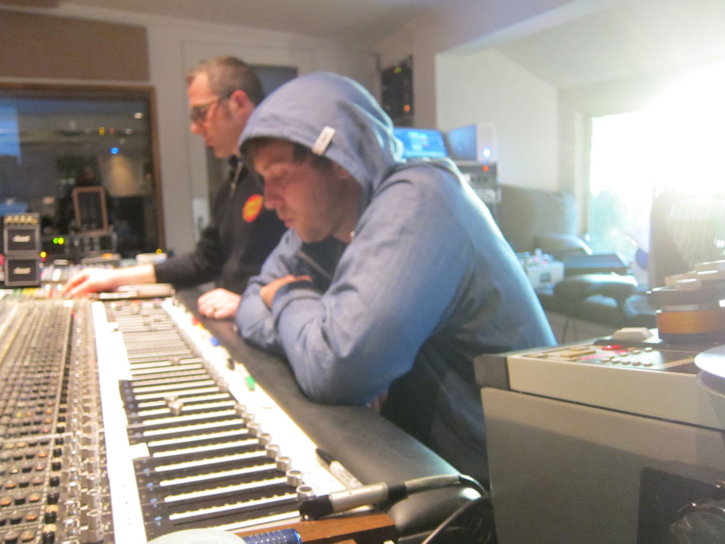 Joel and Derek listening to playback at Shangri-La's API console.