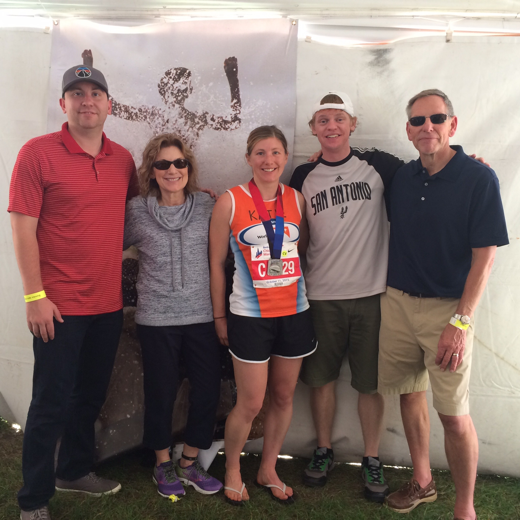 My family and husband joining me after the race. Thank goodness for flip-flops!