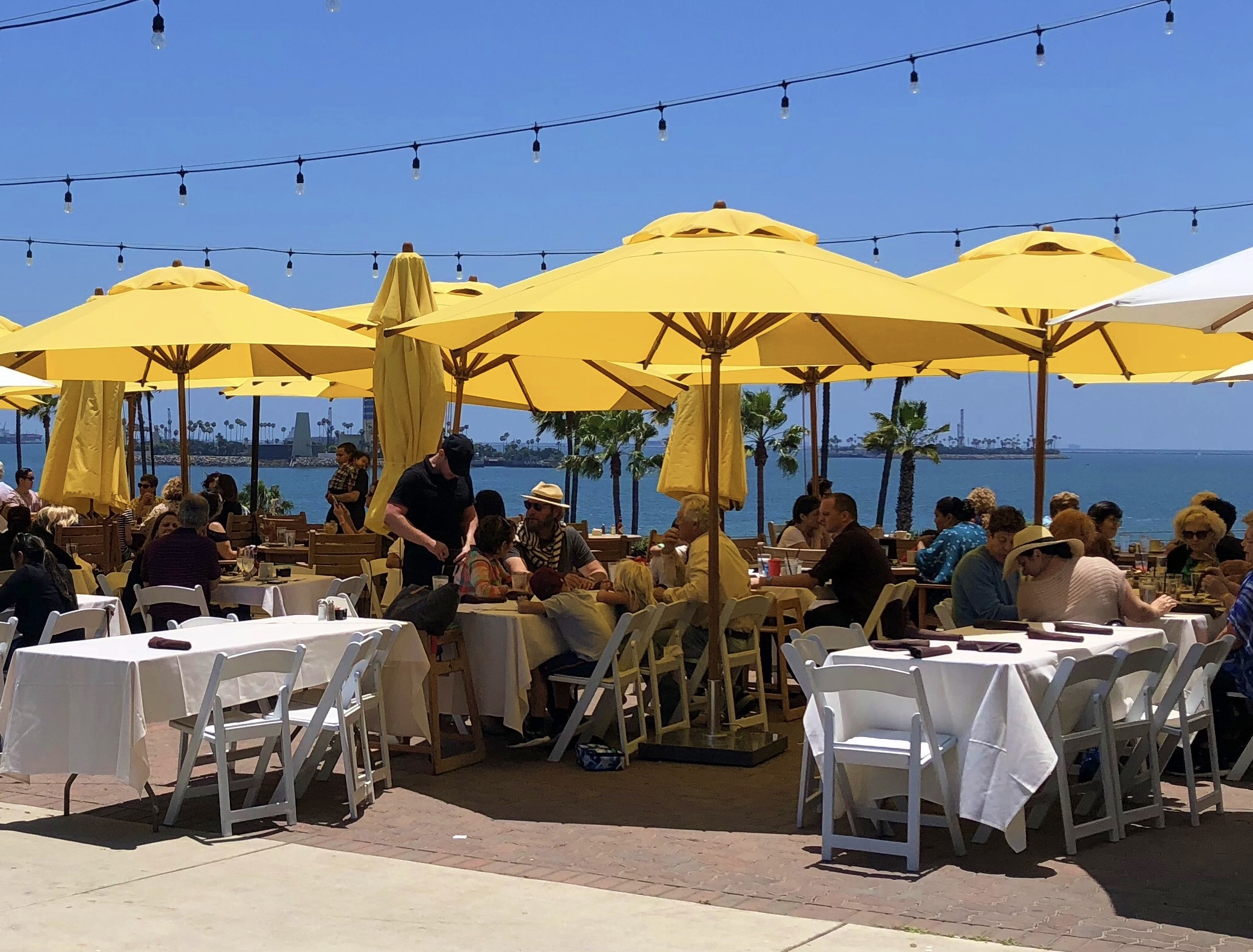 """Our 11.5' Round Levante Market  Umbrellas with a 2"""" pole providing some great  shade at Long Beach Museum of Art!"""