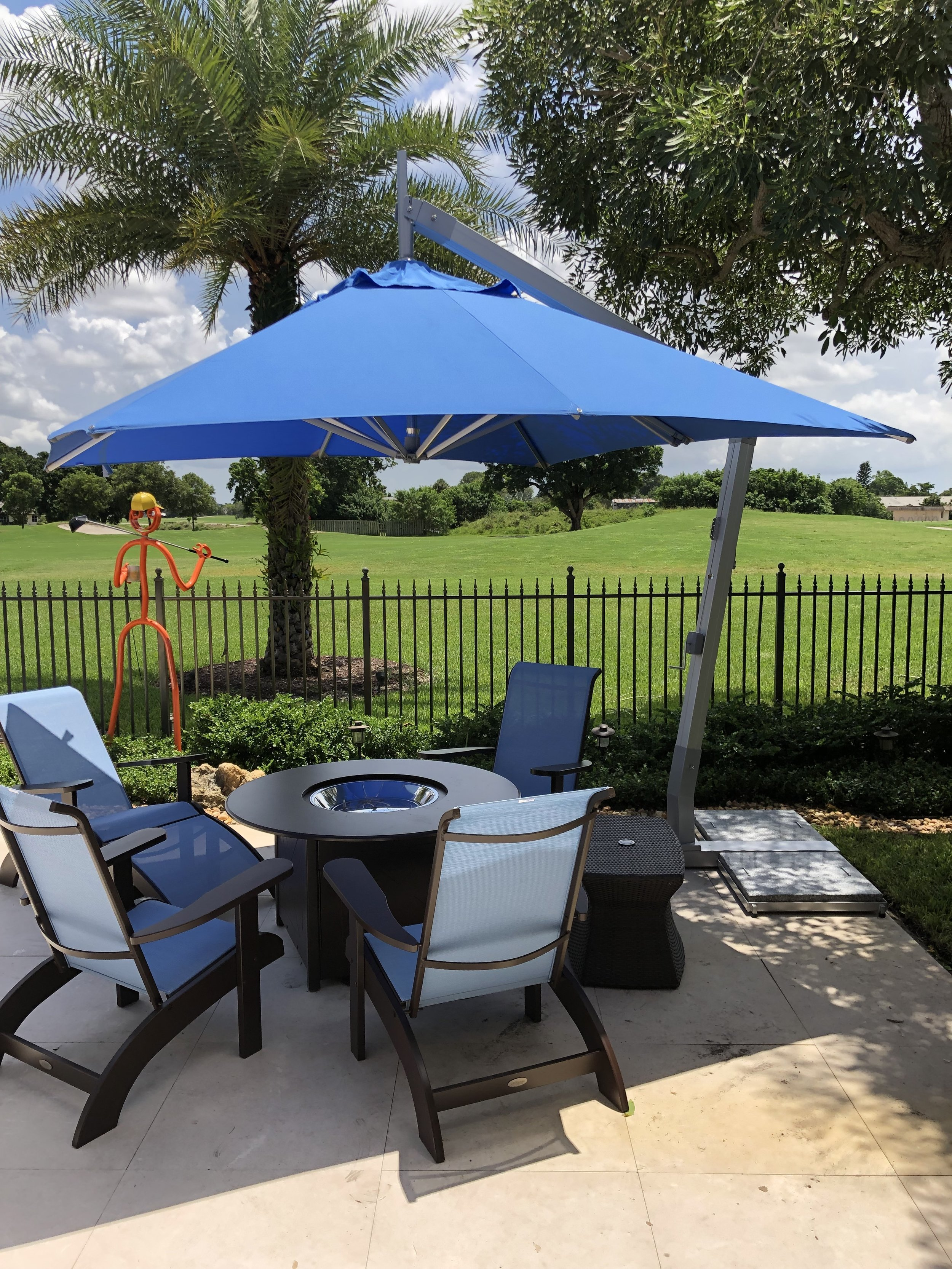 This 11.5' Round Hurricane Side Wind provides great shade for an outdoor fire pit patio set!