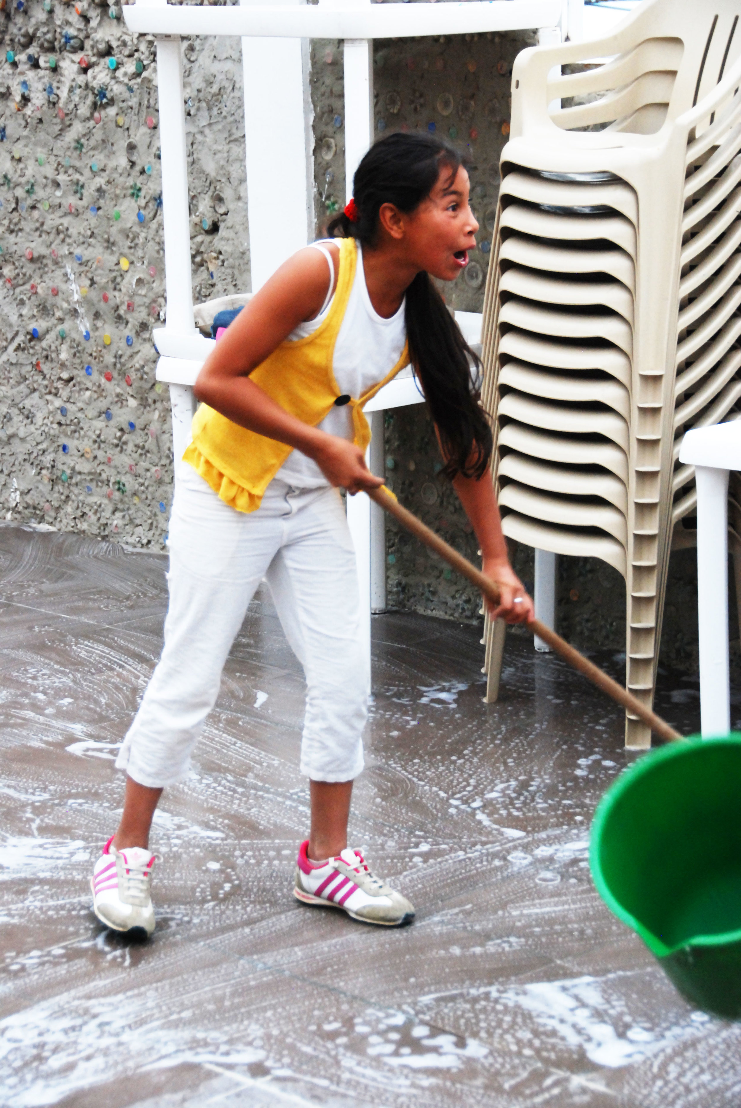 The kids join forces to clean the center after the activities