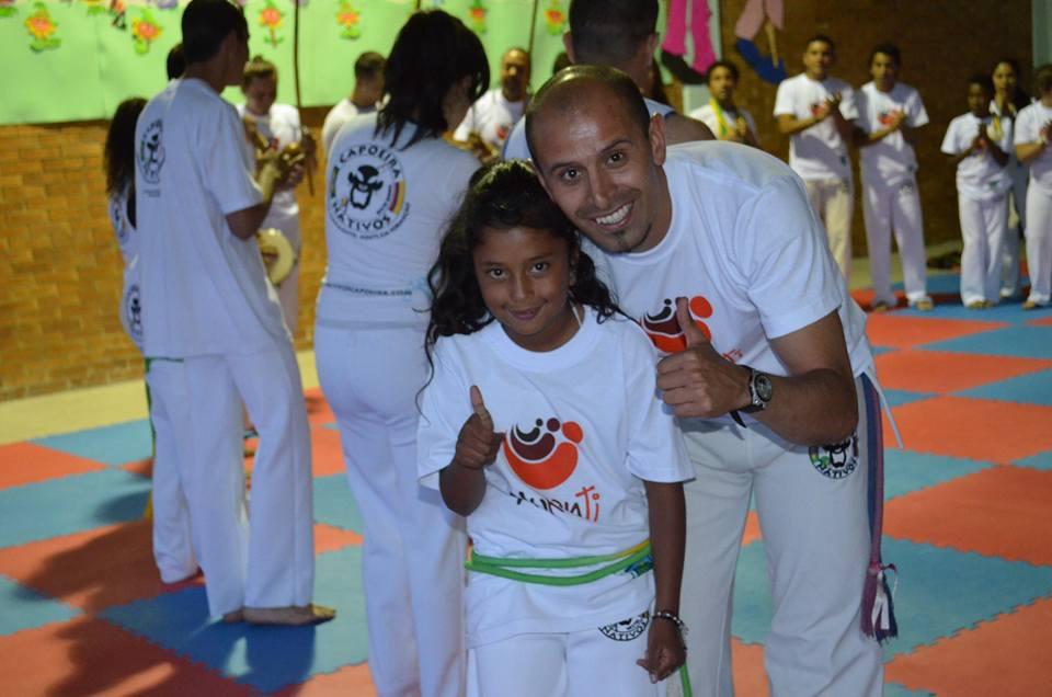 Profe Cristhian with little Jennifer whose Capoeira nickname is India