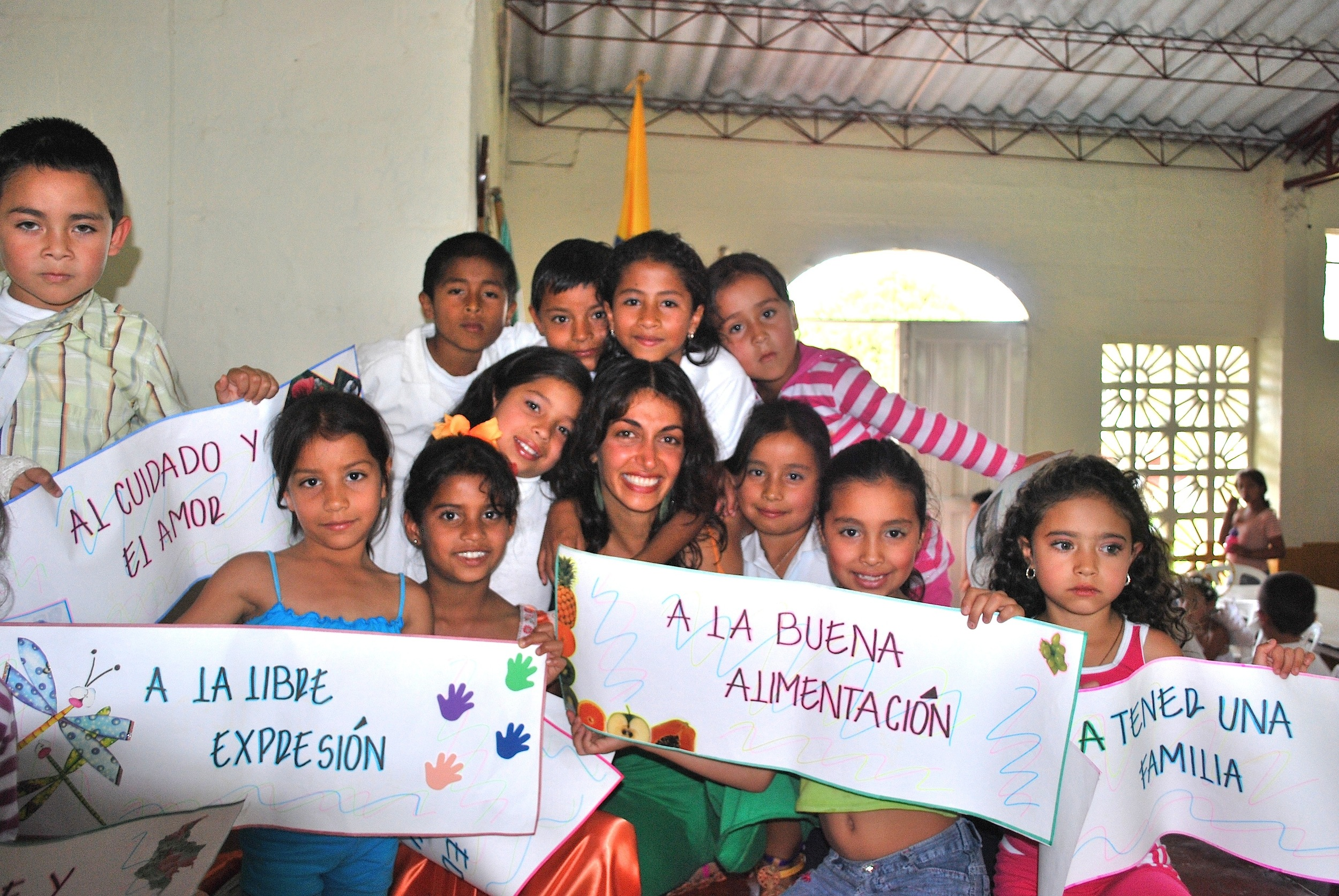 Nukanti's founder Niousha Roshani with Colombian children during the early years of the organization.