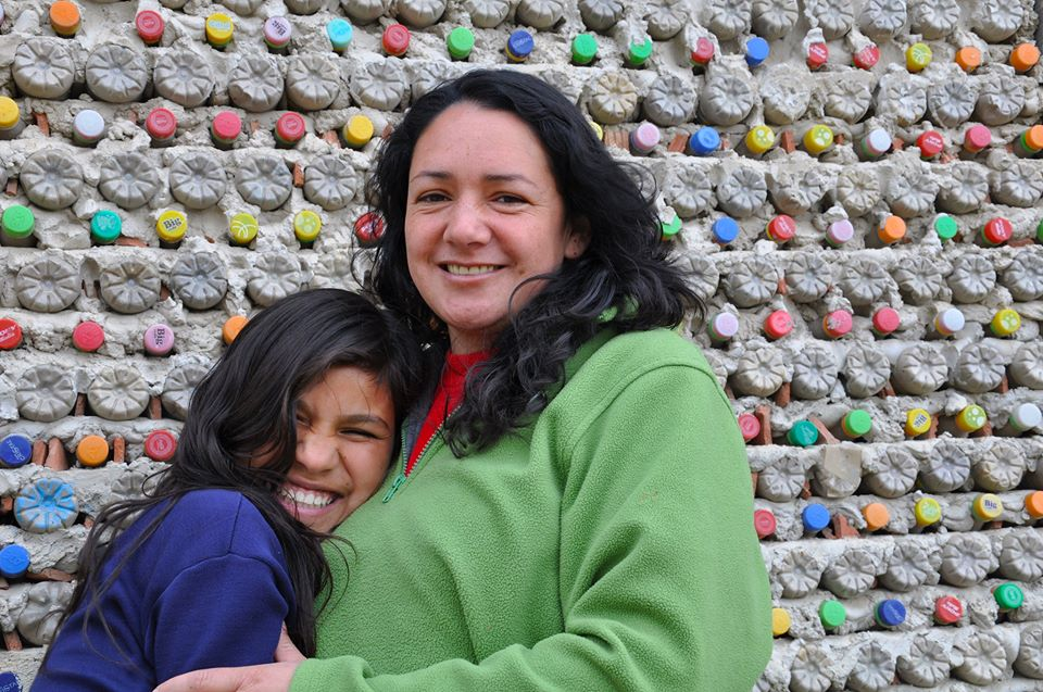 Nohora, community leader and coordinator of Nukanti's Weaving Cazucá project, provides support to the children and families sponsored through the Child Mentoring Program