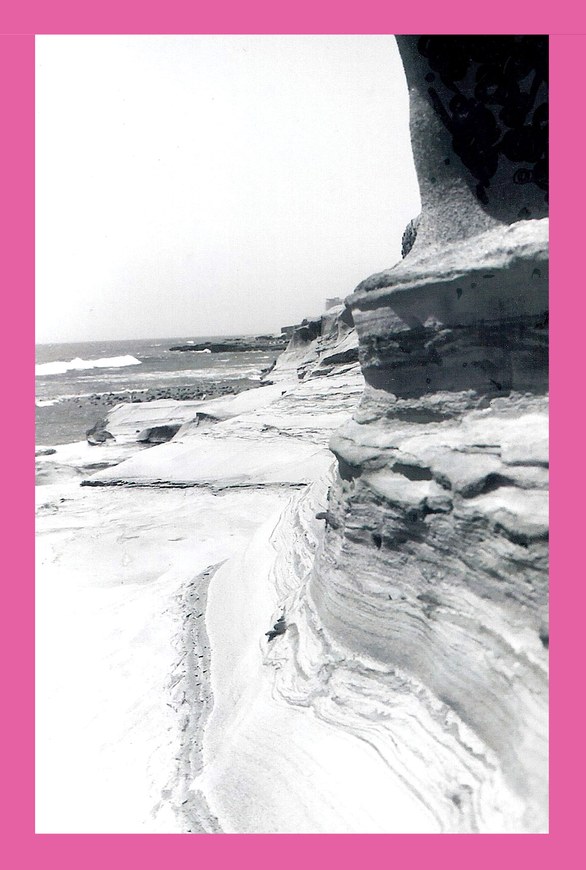 black and white cliffside with prink frame // blog-action