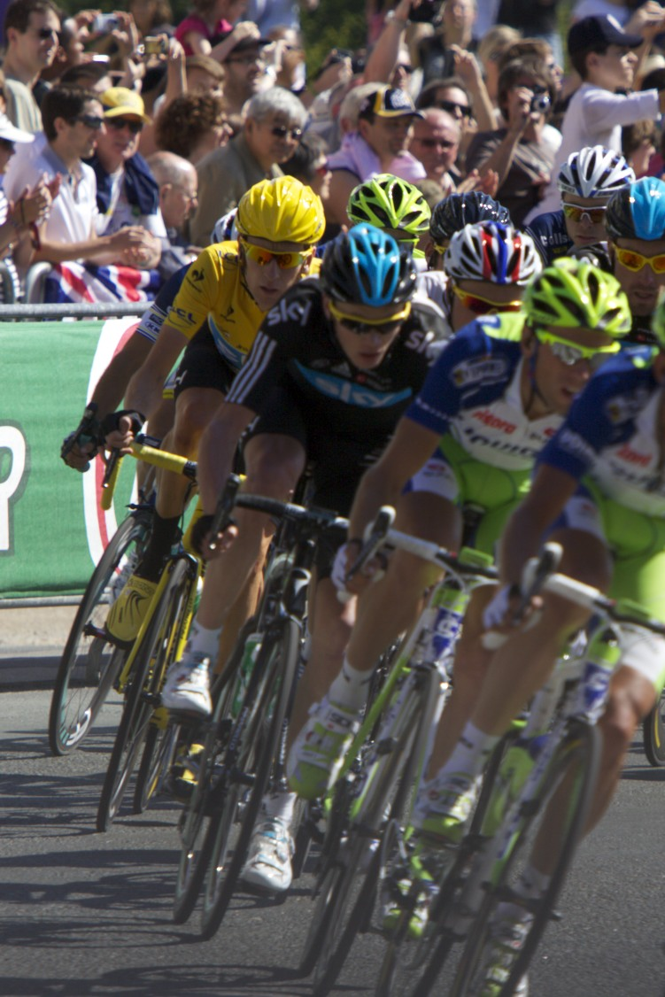 Bradley Wiggins (in the yellow jersey) pops up at Le Tour de France.
