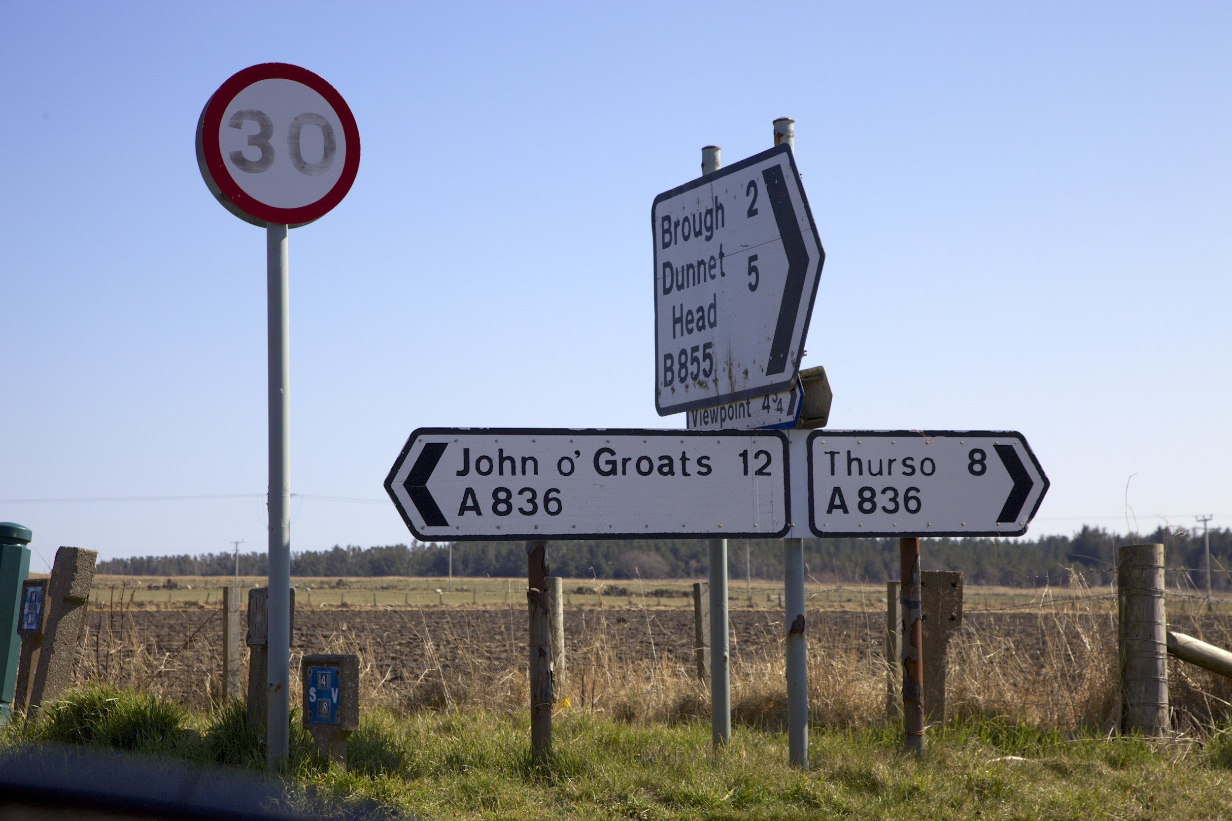 Signs for various unpopular destinations on the way back to Ullapool.  (Scotland.)