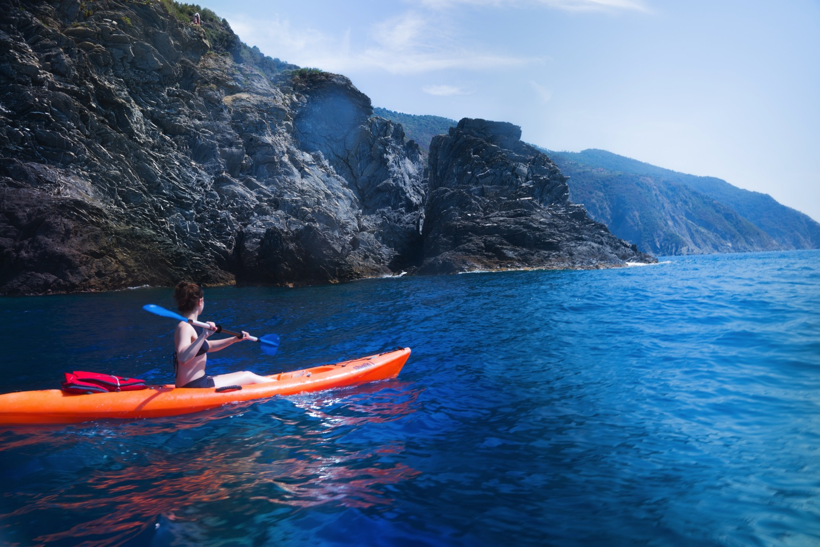 Kayaking south along the coast from Riomaggiore in the Ligurian Sea.   (Liguria, Italy.)