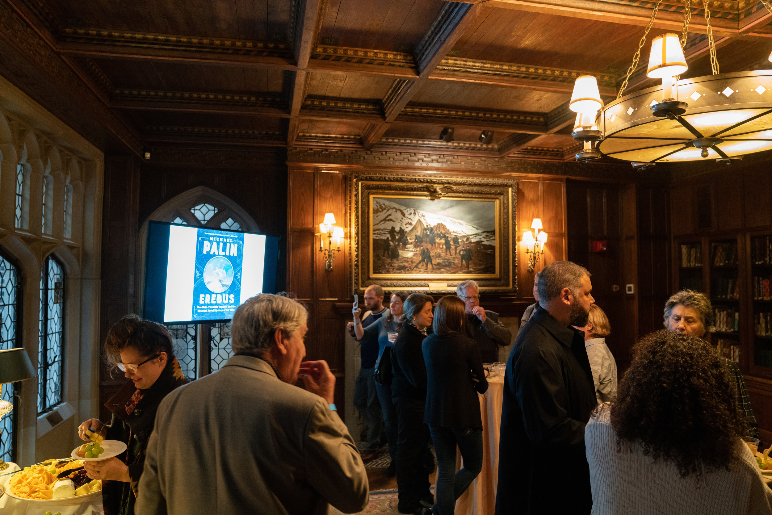 Reception before the talk. The current Explorers Club location at 46 East 70th St was  previously home to Stephen Carlton Clark ,  Singer sewing fortune heir  and  founder of the Baseball Hall of Fame .