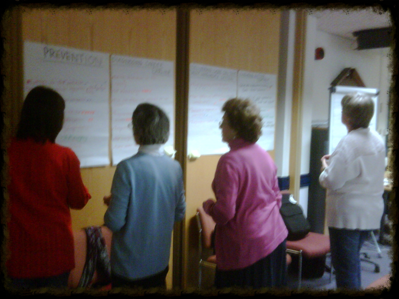 Fellow cancer patients & carers working at a Partnership Group meeting