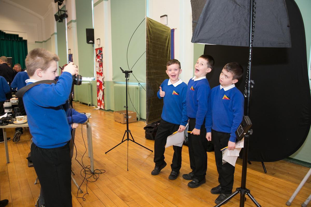 Year 6 pupils taking portraits
