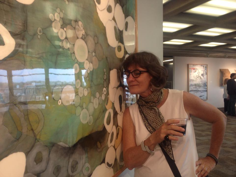 Friend Jeanne Norris, just before she licks my painting- the surface is so sexy, she just can't help it.