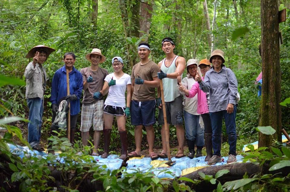 The winning team, Thai-Namic Trio, with community members
