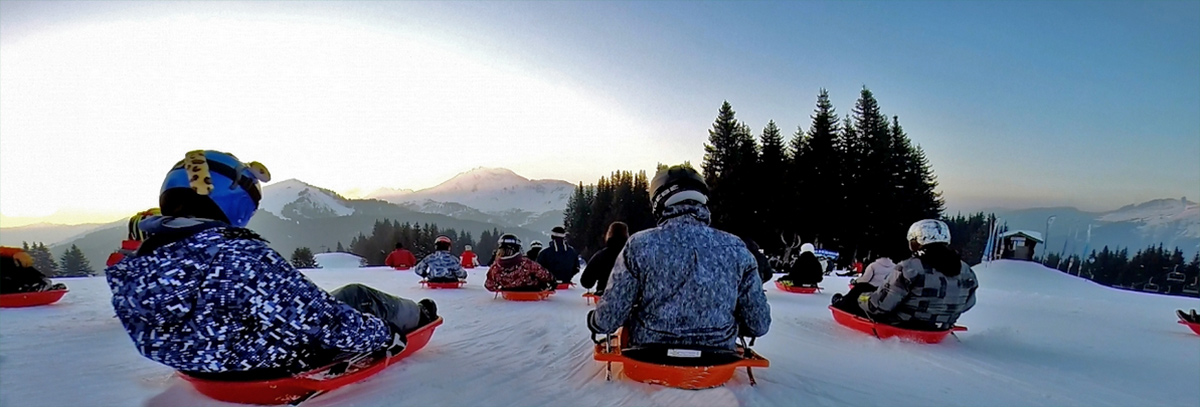 Races your friends down the slopes while skiers enjoy their apres ski. Image courtesy of Morzine.