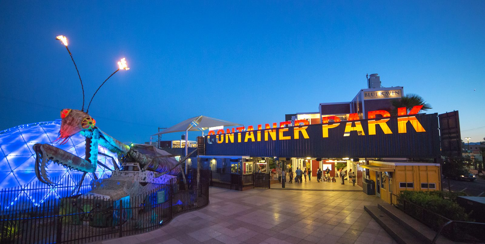 Las Vegas' Downtown Container Park features a Burning Man-inspired praying mantis that shoots fire while jamming out to classic rock tunes. Image courtesy of Downtown Container Park.