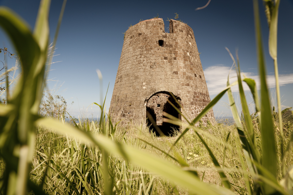 One of the old windmills still to be found on St. Kitts. Image courtesy of the St. Kitts Tourism Authority.