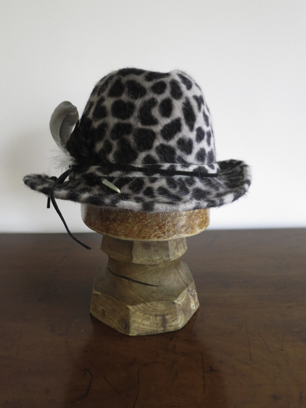 Western Girl. A fun higher crowned top with a western look in lux black and grey leopard Melusine fur felt.