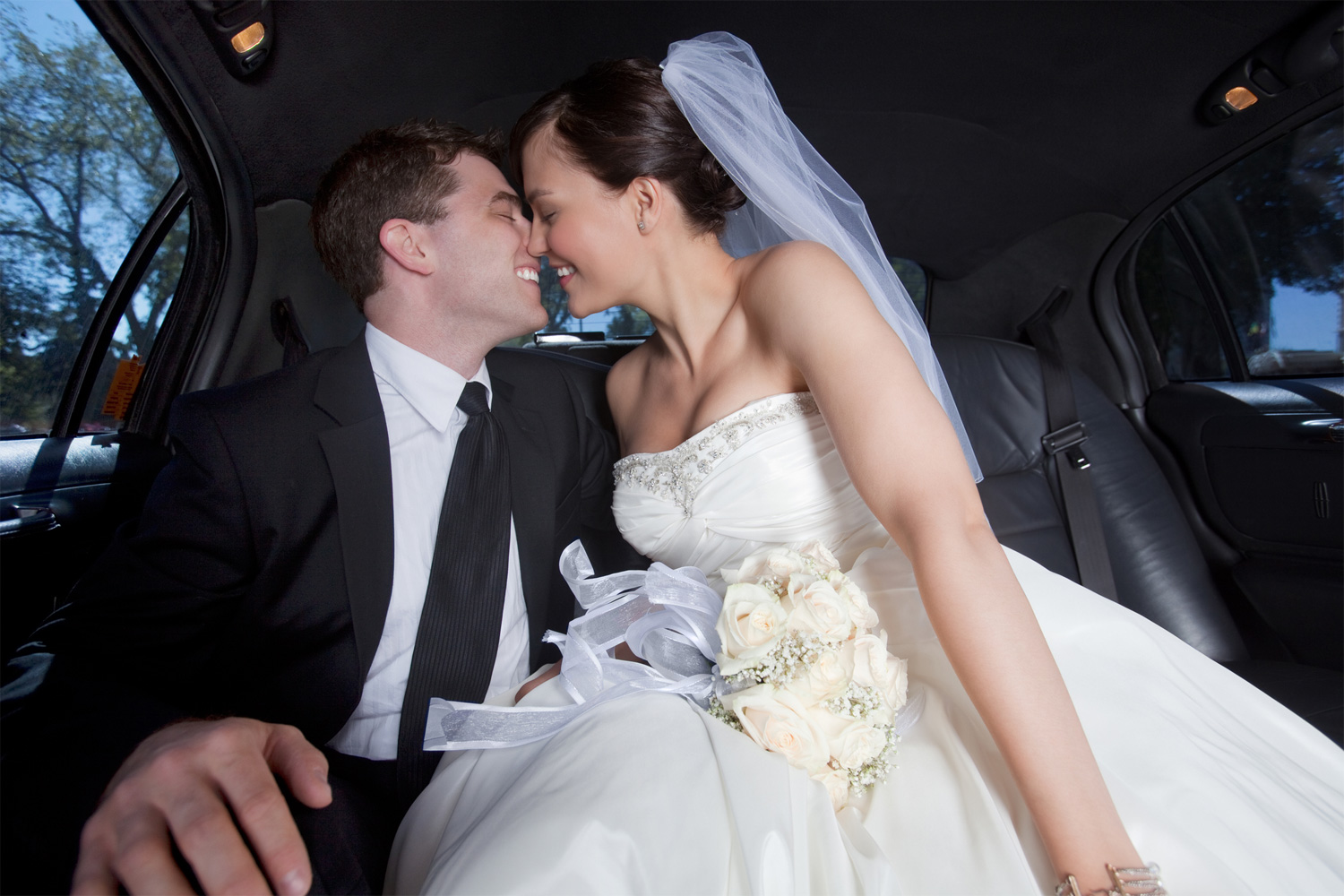 newlywed-couple-in-limousine.jpg
