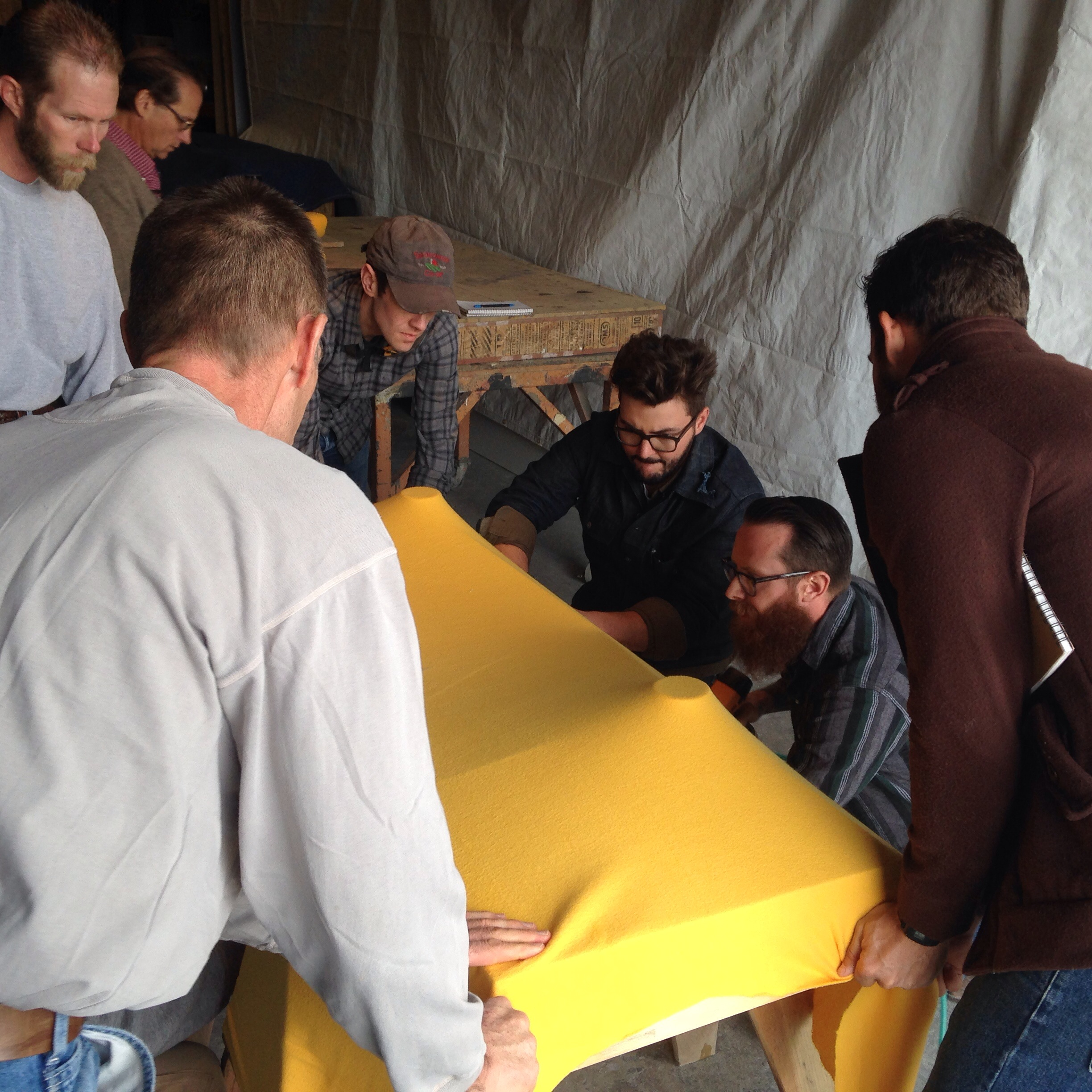 Attendees of a fabric-forming class in the process of creating an aesthetically beautiful and functional concrete sink
