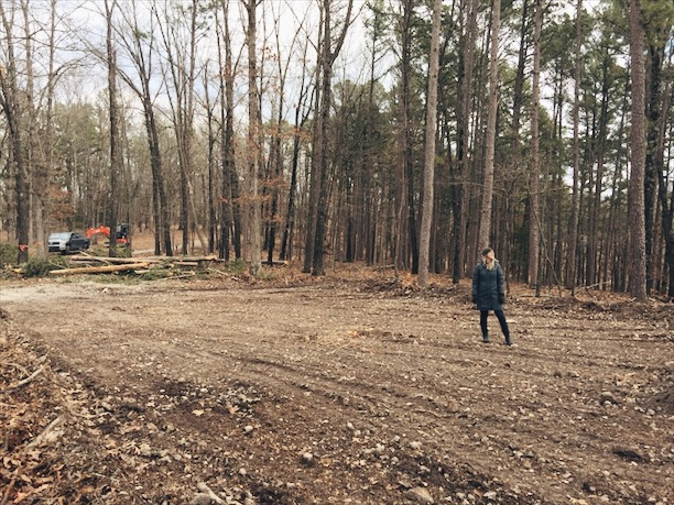 Erin checking out the freshly cleared area for our first building, the garage.