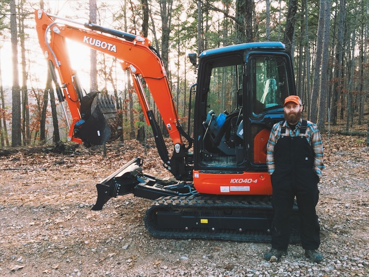 A man and his machine. The excavator has never looked as clean as it did this day.