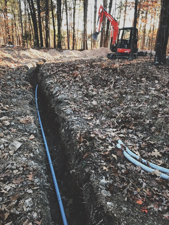 I had to trench over 500' for the electrical service. I only cut my neighbor's internet line 3 times. Also, it snowed the day before and was in the single digits the entire time I was placing the conduit.