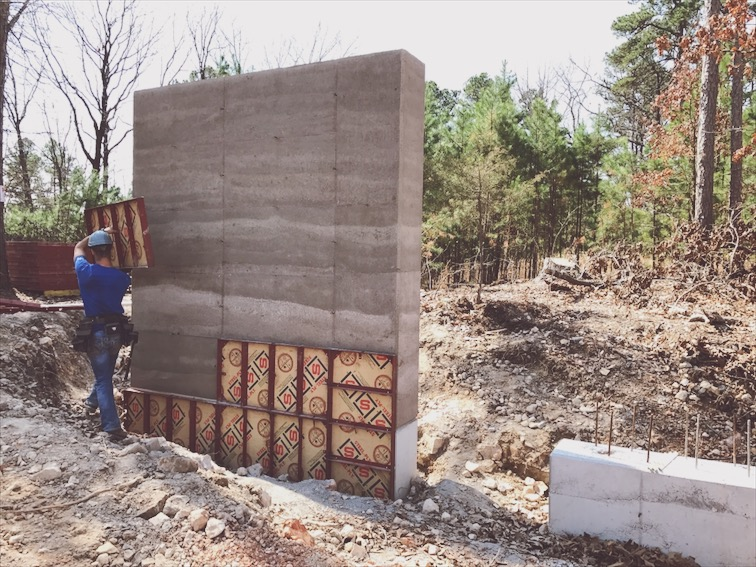 Stripping forms. The layers and texture are what I love about rammed earth. It's as real a material as you can get.