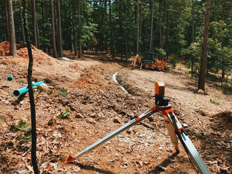 Installing the septic lines. This is where I rolled the excavator.