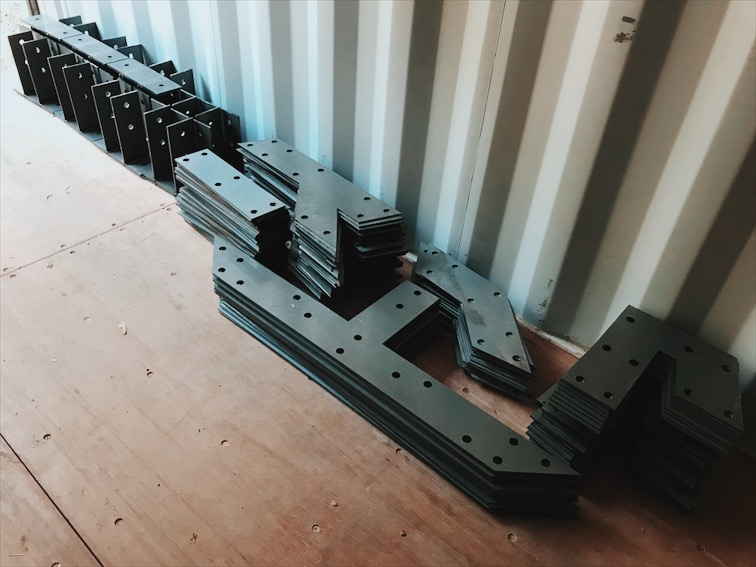 """Custom laser cut gusset plates for the trusses, made from 0.25"""" steel."""